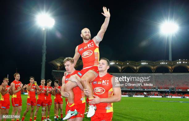 Gary Ablett of the suns is chaired off after his 300th game during the round 15 the Gold Coast Suns and the North Melbourne Kangaroos at Metricon...