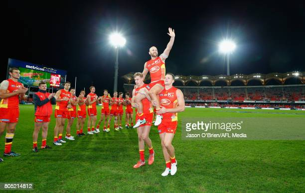 Gary Ablett of the suns is chaired off during the round 15 the Gold Coast Suns and the North Melbourne Kangaroos at Metricon Stadium on July 1 2017...
