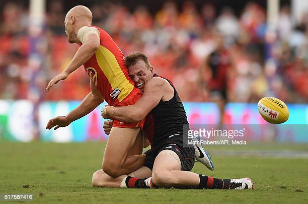 Gary Ablett of the Suns is tackled by Brendon Goddard of the Bombers during the round one AFL match between the Gold Coast Suns and the Essendon...