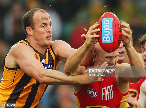 Gary Ablett of the Suns is tackled by David Hale of the Hawks during the round 15 AFL match between the Hawthorn Hawks and the Gold Coast Suns at...