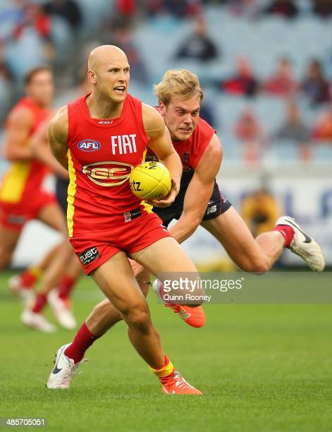 Gary Ablett of the Suns is tackled by Jack Watts of the Demons during the round five AFL match between the Melbourne Demons and the Gold Coast Suns...