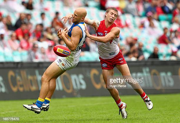 Gary Ablett of the Suns is tackled by Kieren Jack of the Swans during the round two AFL match between the Sydney Swans and the Gold Coast Suns at SCG...