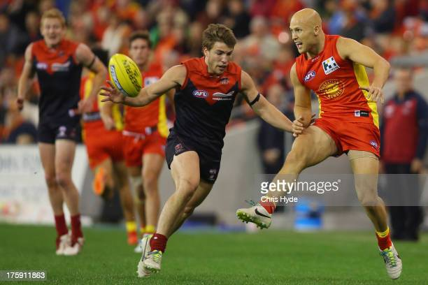 Gary Ablett of the Suns kicks during the round 20 AFL match between the Gold Coast Suns and the Melbourne Demons at Metricon Stadium on August 10...