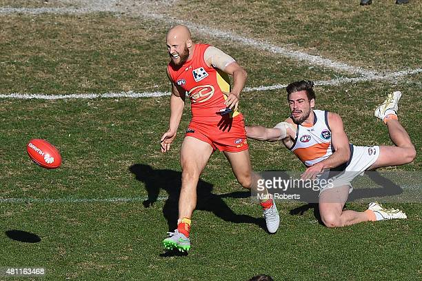 Gary Ablett of the Suns kicks the ball during the round 16 AFL match between the Gold Coast Suns and the Greater Western Sydney Giants at Metricon...