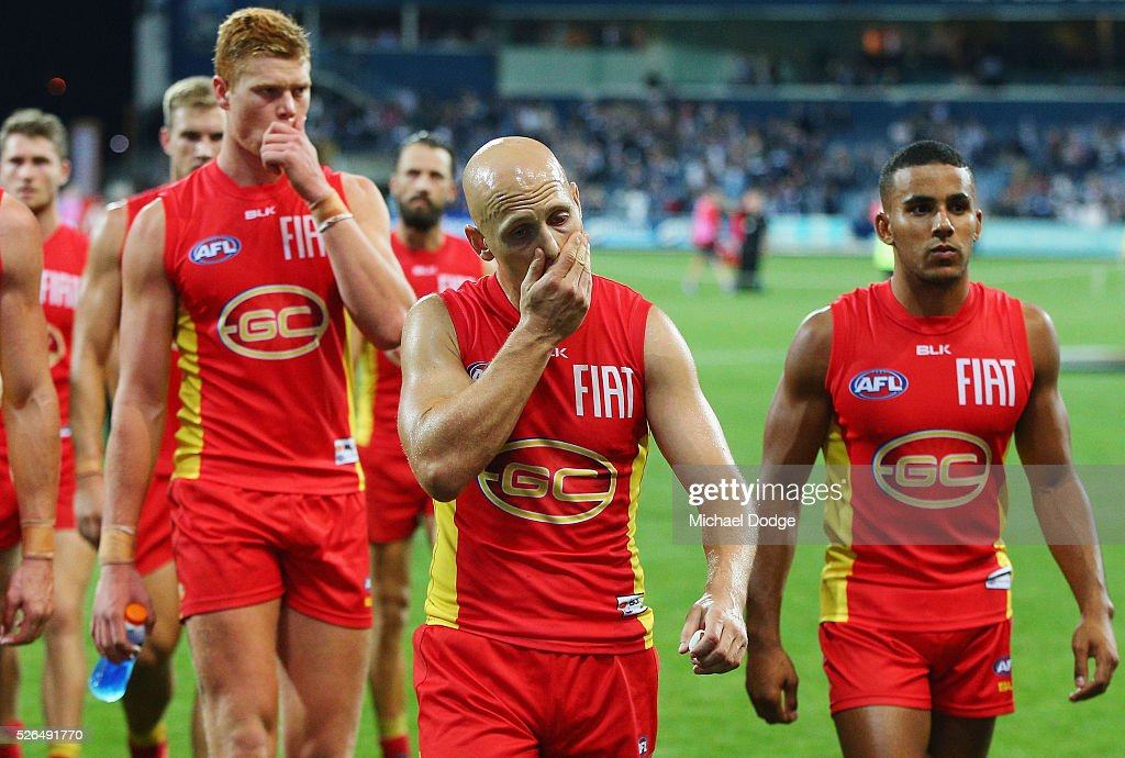 Gary Ablett of the Suns leads the team off after defeat during the round six AFL match between the Geelong Cats and the Gold Coast Suns at Simonds Stadium on April 30, 2016 in Geelong, Australia.