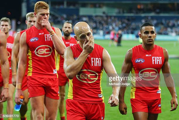 Gary Ablett of the Suns leads the team off after defeat during the round six AFL match between the Geelong Cats and the Gold Coast Suns at Simonds...