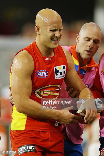 Gary Ablett of the Suns leaves the field injured the round 16 AFL match between the Gold Coast Suns and the Collingwood Magpies at Metricon Stadium...