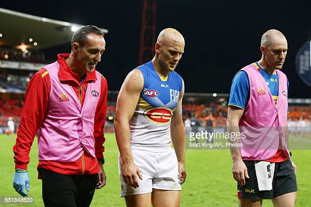 Gary Ablett of the Suns looks dejected as he leaves the field with medical staff after the round eight AFL match between the Greater Western Sydney...