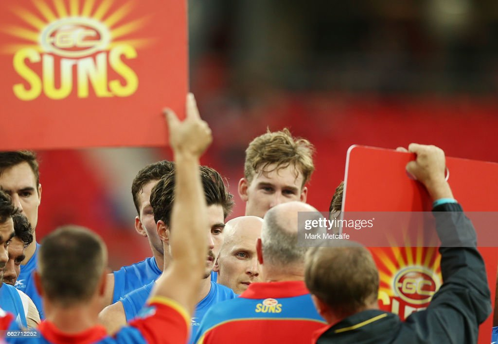 Gary Ablett of the Suns looks on as Suns head coach Rodney Eade gives a three quarter time team talk during the round two AFL match between the Greater Western Sydney Giants and the Gold Coast Suns at Spotless Stadium on April 1, 2017 in Sydney, Australia.