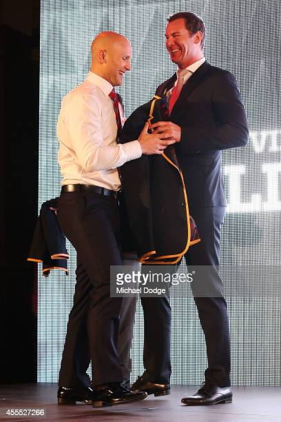 Gary Ablett of the Suns receives his blazer from Wayne Carey after being announced in the All Australian Team Announcement at Royal Exhibition...