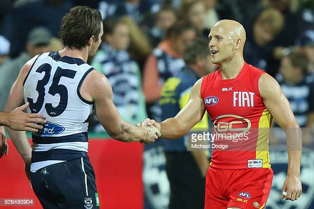Gary Ablett of the Suns shakes hands with Patrick Dangerfield of the Cats after their defeat during the round six AFL match between the Geelong Cats...
