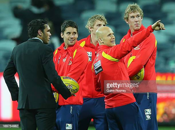 Gary Ablett of the Suns shows his team around Simonds Stadium before the start of the round ten AFL match between the Geelong Cats and the Gold Coast...