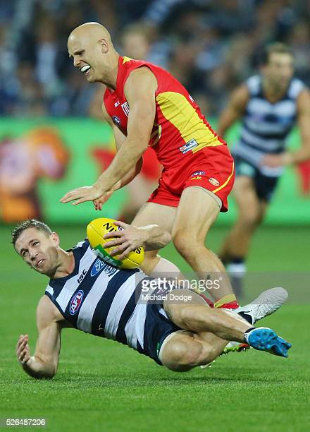 Gary Ablett of the Suns tackles Joel Selwood of the Cats during the round six AFL match between the Geelong Cats and the Gold Coast Suns at Simonds...