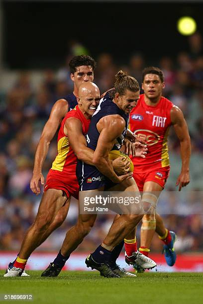 Gary Ablett of the Suns tackles Nathan Fyfe of the Dockers during the round two AFL match between the Fremantle Dockers and the Gold Coast Suns at...