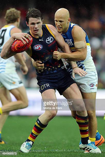 Gary Ablett of the Suns tackles Patrick Dangerfield of the Crows during the round 11 AFL match between the Adelaide Crows and the Gold Coast Suns at...