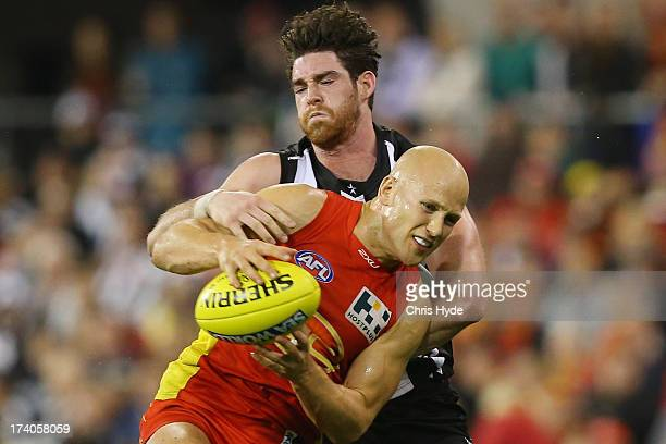 Gary Ablett of the Suns takes a make over Tyson Goldsack of the Magpies during the round 17 AFL match between the Gold Coast Suns and the Collingwood...