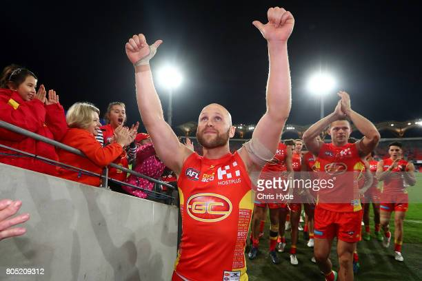 Gary Ablett of the the Suns celebrates after winning and playing his 300th match during the round 15 the Gold Coast Suns and the North Melbourne...