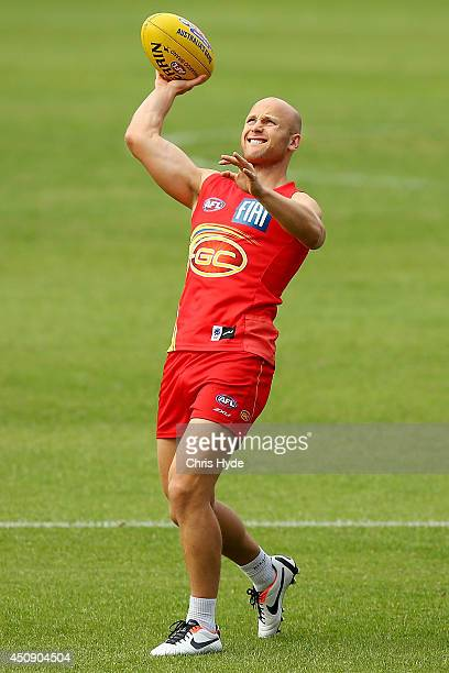 Gary Ablett throws the ball during a Gold Coast Suns AFL training session at Metricon Stadium on June 20 2014 in Gold Coast Australia