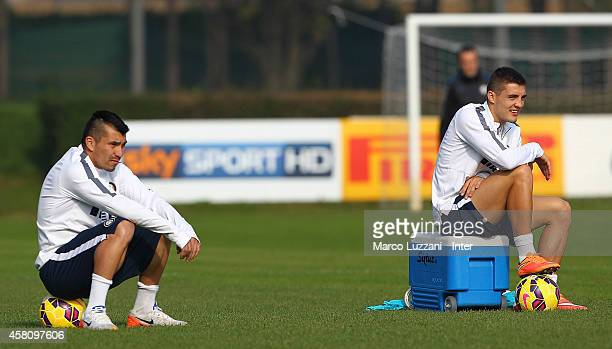 Gary Alexis Medel and Mateo Kovacic of FC Internazionale Milano look on during FC Internazionale training session at the club's training ground on...