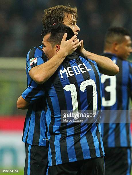 Gary Alexis Medel of FC Internazionale Milano celebrates with his teammate Adem Ljajic after scoring the opening goal during the Serie A match...