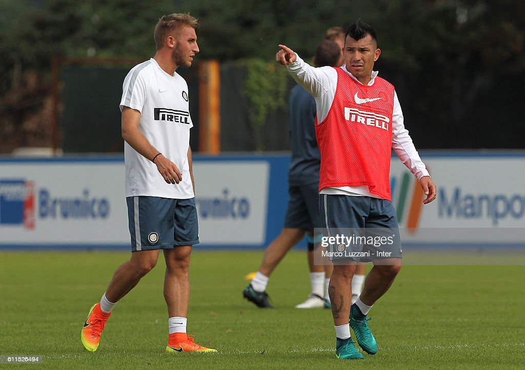 Gary Alexis Medel (R) of FC Internazionale Milano gestures during the FC Internazionale training session at the club's training ground 'La Pinetina' on September 30, 2016 in Como, Italy.