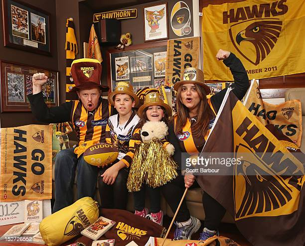 Gary and Chriss Robson pose along with their children Jack and Danielle in their home which is decorated with Hawthorn Hawks paraphernalia during AFL...