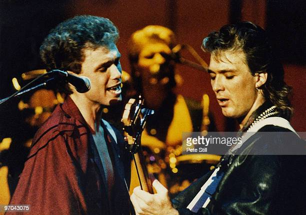 Gary and Martin Kemp of Spandau Ballet perform on stage on the 'Parade' tour at Wembley Arena on December 8th, 1984 in London, England.