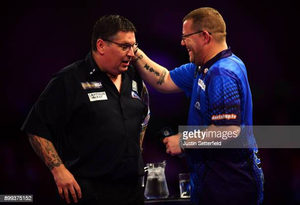 Gary Anderson celebrates winning his Third Round Match against Steve West during the 2018 William Hill PDC World Darts Championships on Day Twelve at...