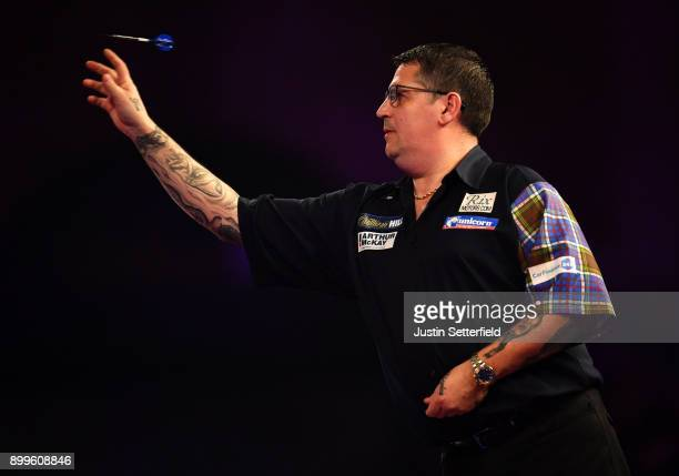 Gary Anderson in action during his Quarter Final Match against Phil Taylor during the 2018 William Hill PDC World Darts Championships on Day Thirteen...