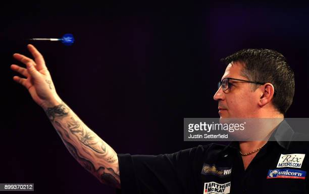 Gary Anderson in action during his Third Round Match against Steve West during the 2018 William Hill PDC World Darts Championships on Day Twelve at...