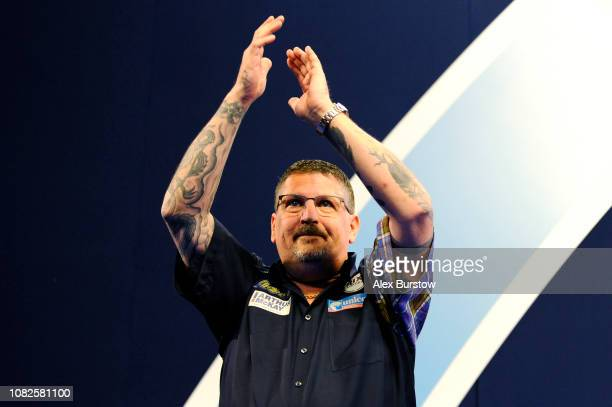 Gary Anderson of England applauds the fans prior to his match against Kevin Burness of Northern Ireland during Day Two of the 2019 William Hill World...