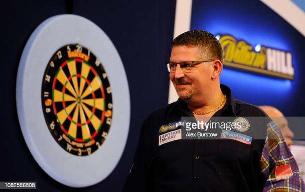 Gary Anderson of England celebrates after winning his match against Kevin Burness of Northern Ireland during Day Two of the 2019 William Hill World...