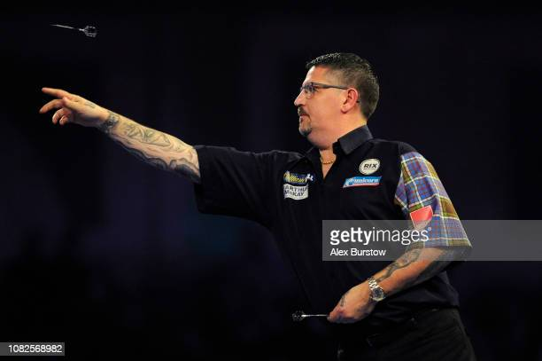 Gary Anderson of England in action against Kevin Burness of Northern Ireland during Day Two of the 2019 William Hill World Darts Championship at...