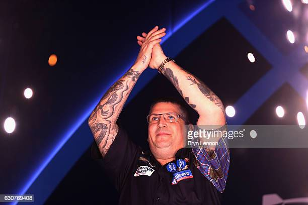 Gary Anderson of Great Britain acknowledges the crowd ahead of his semifinal match against Peter Wright of Great Britain on day fourteen of the 2017...