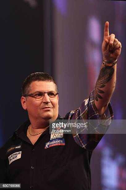 Gary Anderson of Great Britain celebrates beating Peter Wright of Great Britain in their semifinal match on day fourteen of the 2017 William Hill PDC...