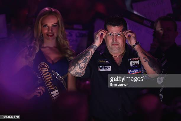 Gary Anderson of Great Britain prepares to 'walk on' for the final of the 2017 William Hill PDC World Darts Championships at Alexandra Palace on...