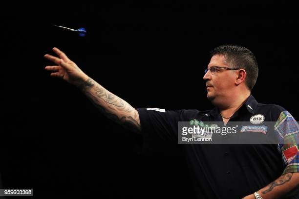 Gary Anderson of Great Britain throws against Micahel Smith of Great Britain in their semifinal during the Betway Premier League Darts PlayOffs at...
