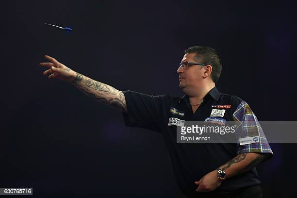 Gary Anderson of Great Britain throws against Peter Wright of Great Britain during their semifinal match on day fourteen of the 2017 William Hill PDC...