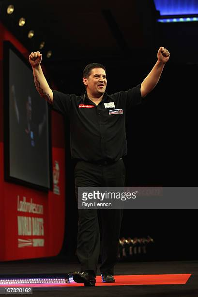 Gary Anderson of Scotland celebrates after beating Andy Smith of England during day 12 in the 2011 Ladbrokescom World Darts Championship at Alexandra...