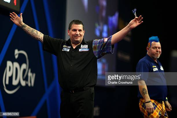 Gary Anderson of Scotland celebrates after winning his quarter final match against Peter Wright of Scotland during the William Hill PDC World Darts...