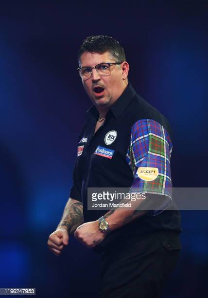 Gary Anderson of Scotland celebrates during his fourth round match against Nathan Aspinall of England on Day 12 of the 2020 William Hill World Darts...