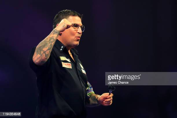 Gary Anderson of Scotland celebrates victory after the Second Round match between Gary Anderson and Brendan Dolan on Day 4 of the 2020 William Hill...