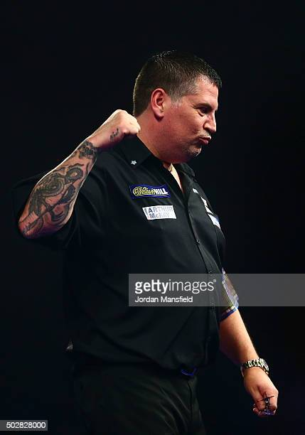 Gary Anderson of Scotland celebrates victory in his third round match against Vincent van der Voort of Holland on Day Eleven of the 2016 William Hill...