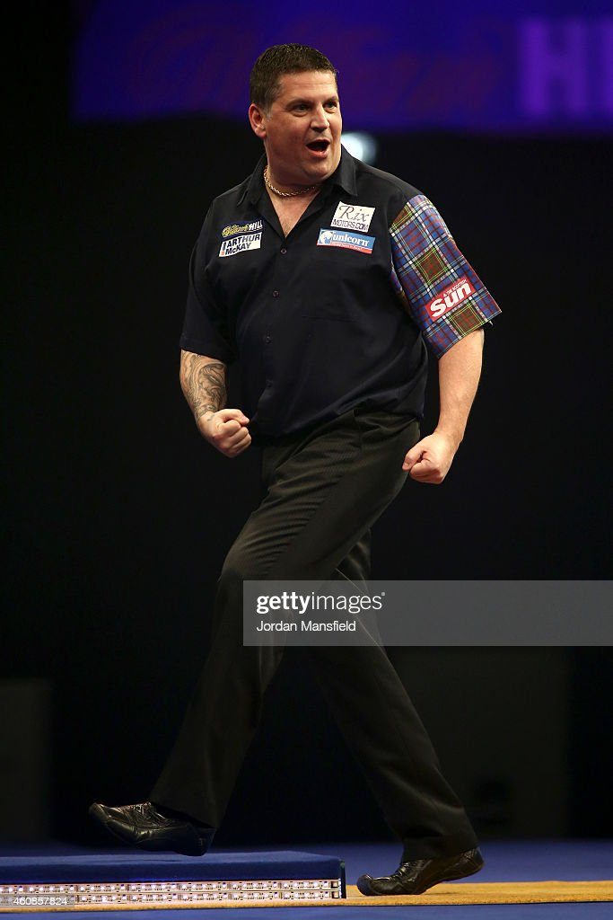 Gary Anderson of Scotland celebrates winning a leg during his second round match against Jelle Klaasen of the Netherlands on Day Seven of the William Hill PDC World Darts Championships at Alexandra Palace on December 27, 2014 in London, England.