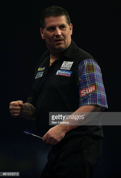 Gary Anderson of Scotland celebrates winning a set during the final of the 2015 William Hill PDC World Darts Championships at Alexandra Palace on...