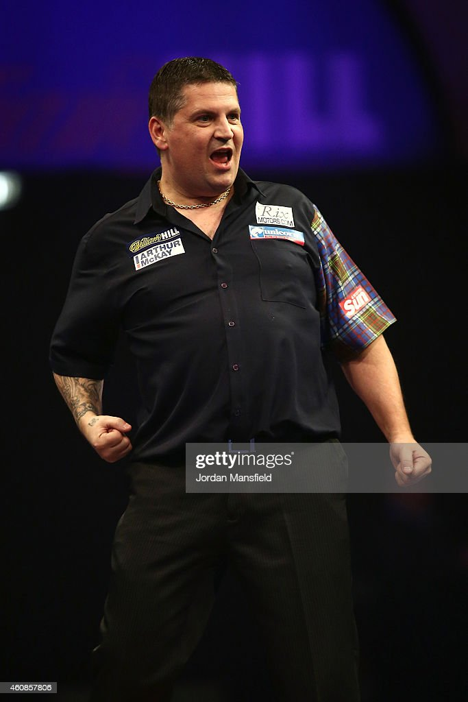 Gary Anderson of Scotland celebrates winning his second round match against Jelle Klaasen of the Netherlands on Day Seven of the William Hill PDC World Darts Championships at Alexandra Palace on December 27, 2014 in London, England.