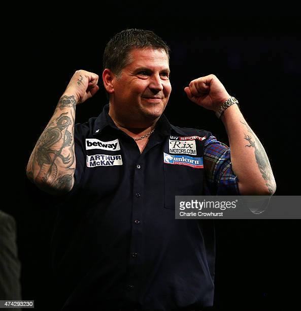Gary Anderson of Scotland celebrates winning the Final against Michael van Gerwen of Holland during the Betway Premier League at The 02 Arena on May...