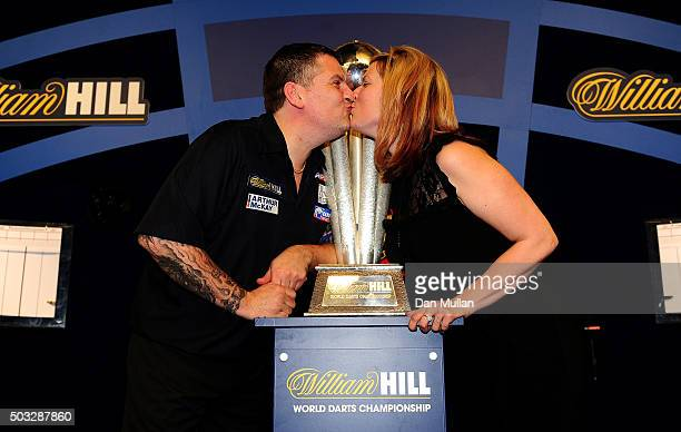 Gary Anderson of Scotland celebrates with his partner Rachel Ford and the Sid Waddell Trophy after defeating Adrian Lewis of England in the final...