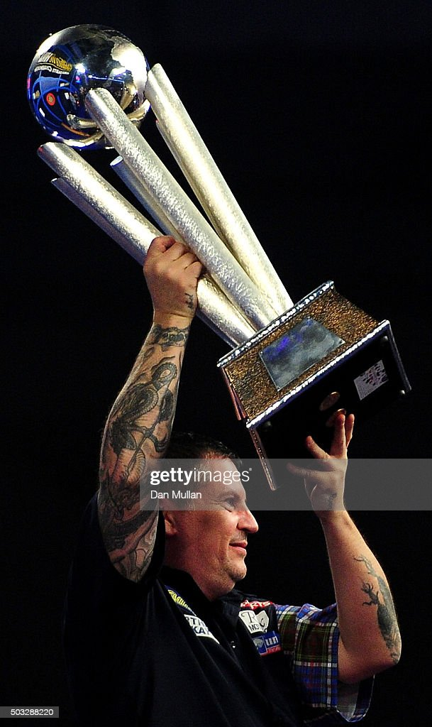 Gary Anderson of Scotland celebrates with the Sid Waddell Trophy after victory over Adrian Lewis of England in the final match during Day Fifteen of the 2016 William Hill PDC World Darts Championships at Alexandra Palace on January 3, 2016 in London, England.