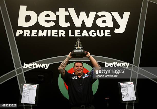 Gary Anderson of Scotland celebrates with the trophy after winning the Final against Michael van Gerwen of Holland during the Betway Premier League...